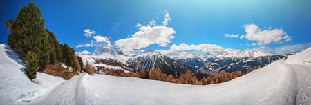 Panoramic view on snowy peaks of Saint-Luc mountains, Switzerland