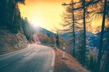 View of mountain road at sunset, Alps Switzerland. Winter nature background Stock Photo