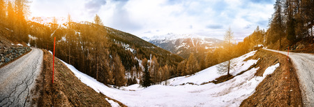 View of mountain road, Alps Switzerland. Panoramic winter nature background