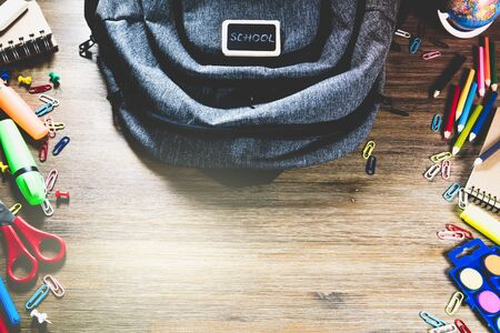 Backpack with school supplies. Back to school concept with copy space Imagens