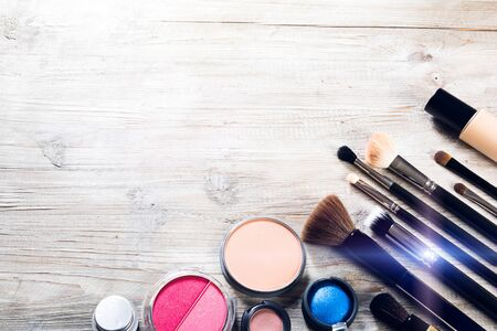 Colorful set with various makeup products and brushes. Beauty background