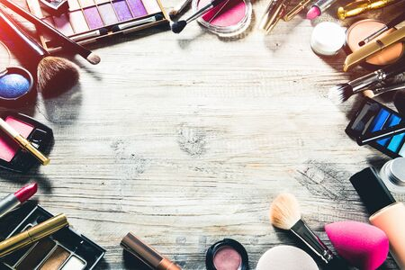 Colorful frame with various makeup products. Beauty background Stok Fotoğraf
