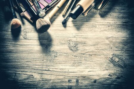 Makeup set with various cosmetic products and brushes. Beauty background