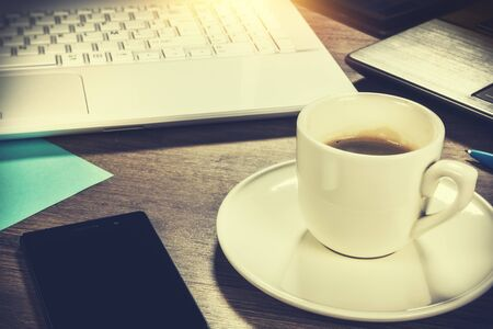 Business concept with coffee cup. Online business, banking, consulting, management concept