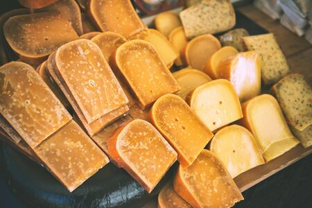 Selection of Dutch cheese at farmers traditional market. Food background Stok Fotoğraf
