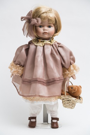 bear s: Ceramic porcelain handmade doll with blond hair and pink dress
