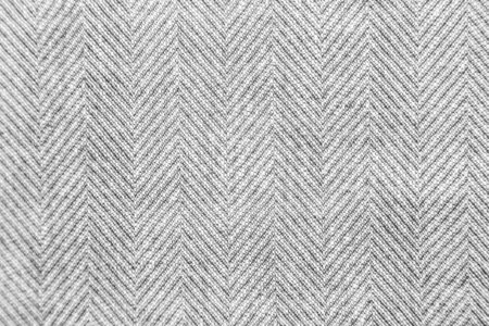 Wool fabric with bright gray and white geometric minimalistic pattern.