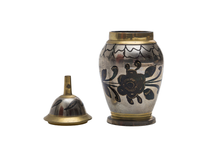 Antic silver engraved dyed metal vase in oriental style with a floral pattern on isolated background Stock Photo