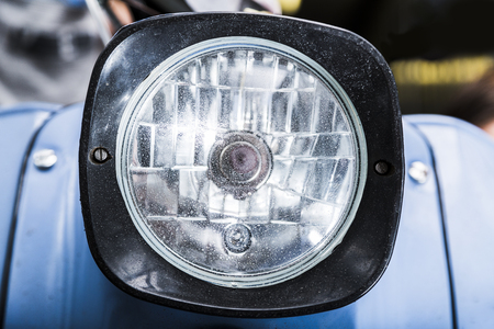 Motorcycle vintage old dirty headlight close up