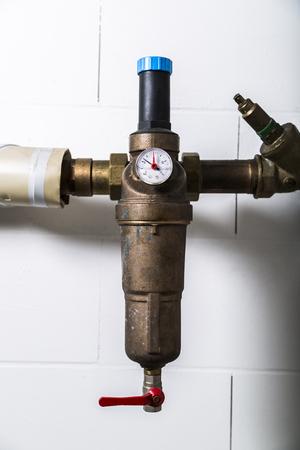 Water meters on metallic rusty water pipe