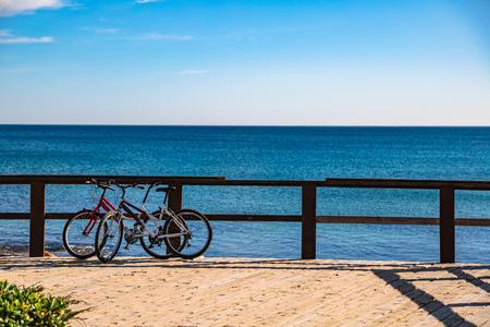 Couple of bicycles on pier near sea in Spain