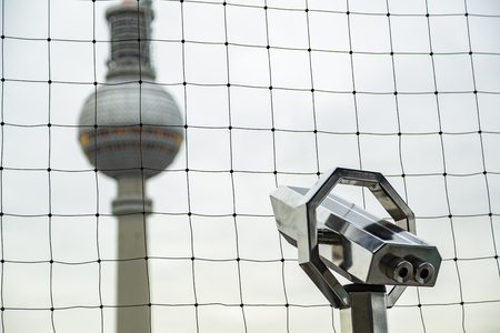 Blurred image of TV tower Fernsehturm in Berlin with telescope on observation deck Imagens