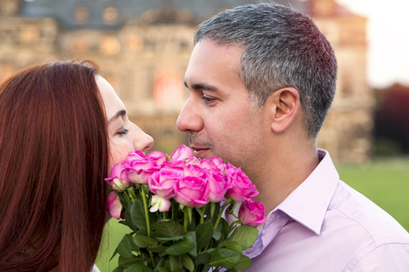 Close up portrait of couple with bouquet ouotdoors
