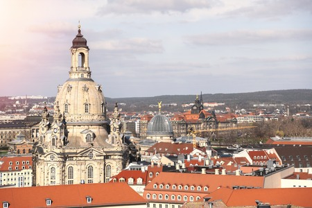 Top view over roof to Frauenkirche in Dresden city in sunny spring day