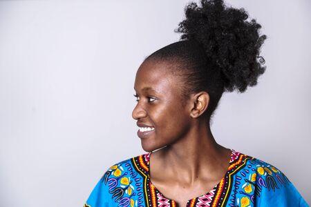 Portrait of smiling african girl in blue dress Reklamní fotografie