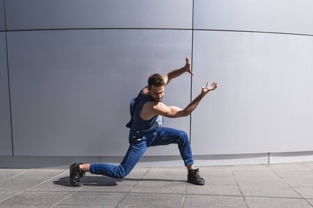 Young handsome man dancer shows contemporary dance