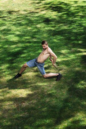 Man dancer of ballet or contemporary dance in park 免版税图像
