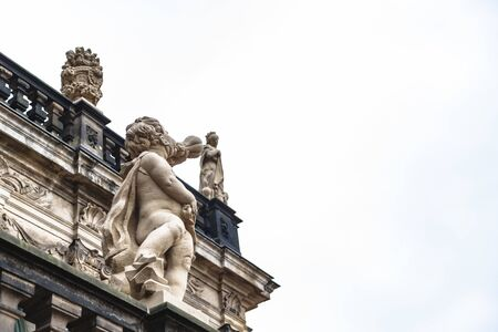 Little angel blows in horn in Zwinger of Dresden Stock Photo