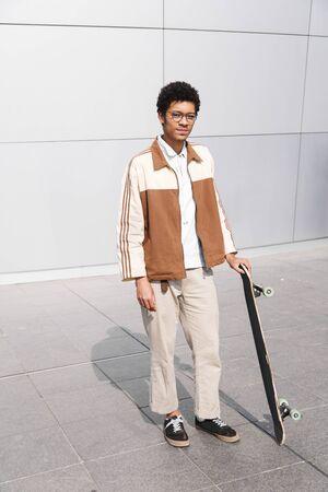 Full-length shot of afro-american young skater man Reklamní fotografie