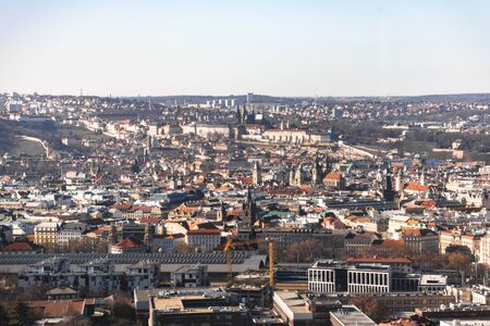 Prague cityscape with churches and train station