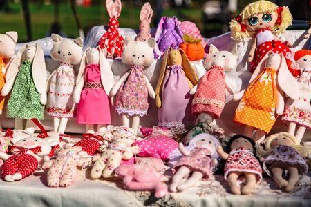 Large assortment of rag animal dolls on fall fair