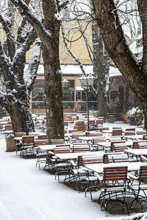 Outdoor cafe without visitors under falling snow Reklamní fotografie