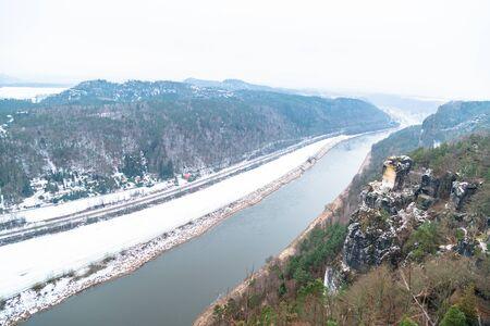 Road along Elbe river in winter, Saxony, Germany