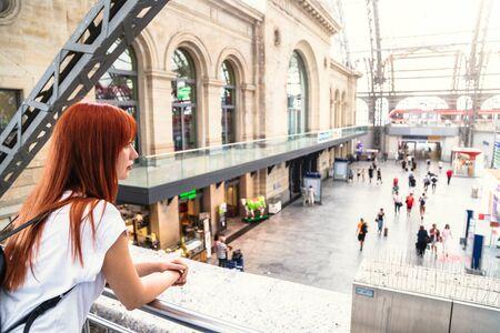 Close up hands woman using phone at train station Zdjęcie Seryjne