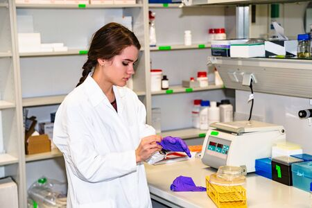 Female student or lab assistant working in lab