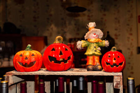 Orange ceramic pumpkin heads and scarecrow for halloween in store