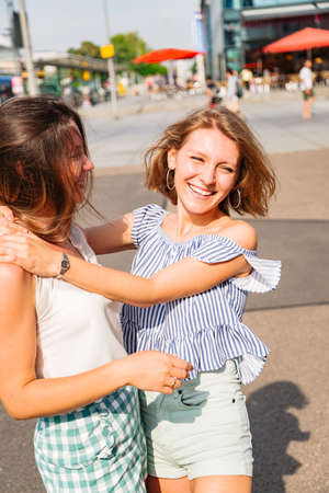 Portrait of two girls friends hugging each other