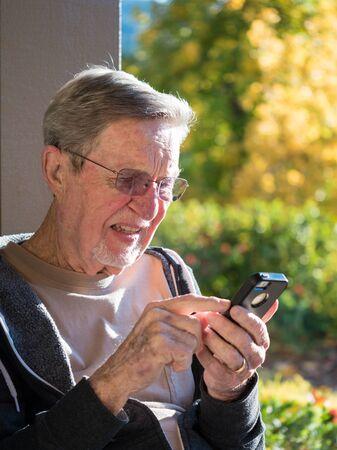 Elderly male using cell phone