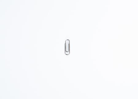 Single Paper Clip in Centre of White Background Archivio Fotografico - 120506279