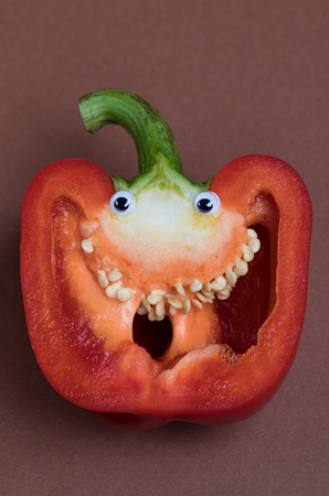 Red Pepper Face with Eyes and Teeth Archivio Fotografico - 123345818