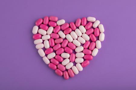 Candy Heart on Purple Background Archivio Fotografico - 123345823