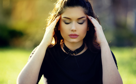 Sad Depressed Girl With Migraine. Outdoor Portrait. Stress and Depression Concept. Stock Photo