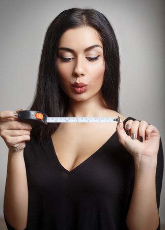 Female With Measuring Tape.  photo