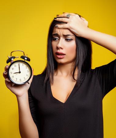Running Late Female. Woman Holding Clock photo