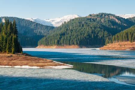 Frozen lake in the mountains photo