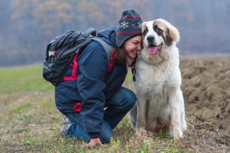 Young girl showing affection to her Bucovina shepherd dog  photo