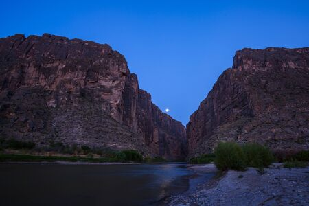 Moon over Santa Elena Canyon, Big Bend National Park, USA, showing evening sunrays. Stock Photo