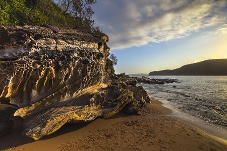 Rock patterns at Bouddi Beach at evening sunset