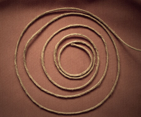 hank: Hank of rope or string on fabric background Stock Photo