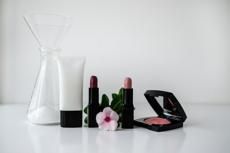 cosmetic laboratory research and development . science bio make up,lipstick product with leaves. natural organic beauty cosmetics concept. cosmetology.