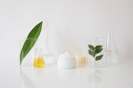 laboratory equipment for alternative medicine, science experiments, formulating organic skincare, herbal medicine and natural remedy pharmaceutical. white background