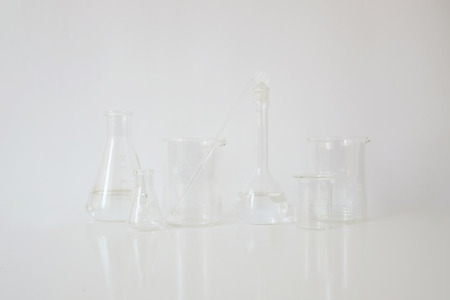 laboratory equipment glassware  for alternative medicine, science experiments, formulating organic skincare, herbal medicine and natural remedy pharmaceutical. white background Stockfoto