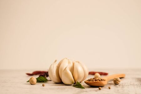 Garlic clove on stone top view .Flat lay composition with herb and nut seed