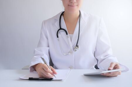 doctor prescribe the medicine and medical program in the hospital office by use technology  tablet.