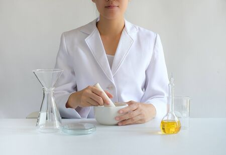 dermatologist and scientist making skin care and cosmetic with natural oil.
