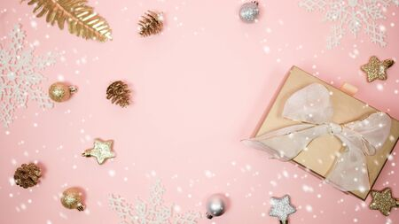 2020 Christmas and new year background banner with the beautiful decor open gift for holiday in winter. On bright pink, golden and silver color theme with snowflake. top view with copy space. 版權商用圖片